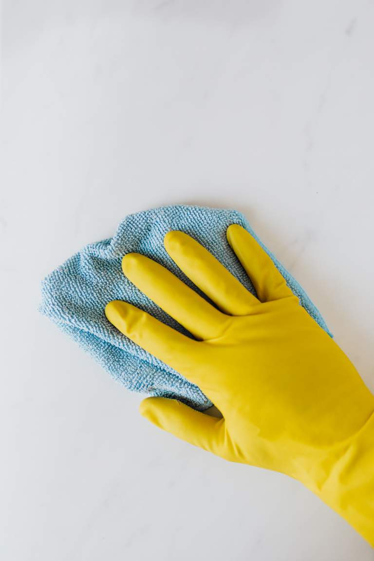 cleaning walls with rag
